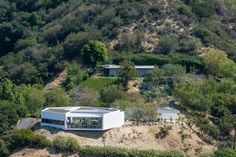 Two architectural gems on one enormous La Crescenta property! At the top, Richard Neutra's Dorothy Serulnic Residence. In the foreground, Michael Maltzan's Pittman-Dowell Residence. Both homes are surrounded by hundreds of beautiful cacti and succulents.