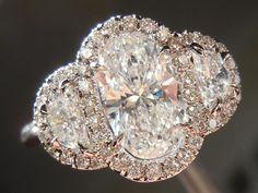 1.01ct Oval Shape F/SI2 Diamond    Diamond Halo Three Stone Ring