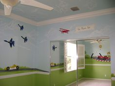 Another example of a boy room w/ a chair rail, kinda looks like the blue angels jets on the wall. and more pics on this link