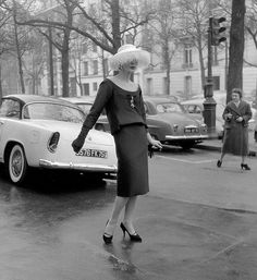 1958 Lucky in an elegant two-piece dinner_cocktail dress by Yves Saint Laurent, photo by Willy Maywald, Paris