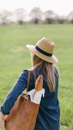 Picnic ready in a straw fedora.