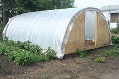 How To Build A Simple DIY Hoop-Style Greenhouse http://www.livinggreenandfrugally.com/how-to-build-a-simple-diy-hoop-style-greenhouse/