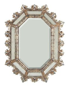 Lovers of old, ornate mirrors, rejoice - the Spanish Mirror In Arezzo is a beveled mirror surrounded by eglomised mirror parts and an arezzo and silver gilt finish. #mirror #johnrichard