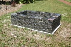 Supersized dark rectangle fire pit ready for a party.  This is made of solid granite and is 100% recycled material.  Check out www.foreverstone.biz for more info.