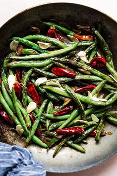 Beautifully blistered and glistening with a just-enough slick of spicy, savory, garlicky oil, these Chinese restaurant-style dry-fried green beans are a scene-stealing side that's ready in a flash.