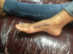 My first tattoo..it's the motto that I try my hardest to live by Carpe Diem=Seize the Day (Latin) A constant reminder to Live Life With No Regrets