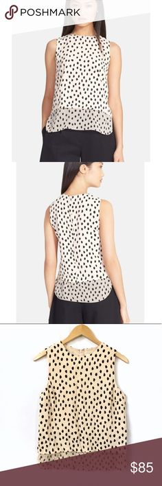 Kate Spade Leopard Dot Layered Tank Blush, layered tank top with black snow leopard dots. Zipper in back. Upper portion - 100% viscose, lower portion - 100% silk, lining - 100% polyester. Color is best represented in picture 4. Underarm to underarm - 18 inches. Length - 23.5 inches. Originally $228. Dry clean only. kate spade Tops Tank Tops