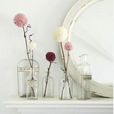 With different color flowers and a little decorating of the bottles=super cute.