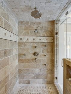 Despite this being a shower entirely made of tile, I love it. Double waterfall shower heads, a place for your shampoo, bodywash, etc.  Love it!