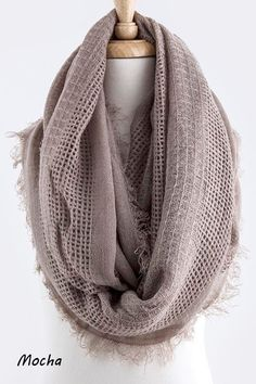 """As weather turns cool, lightweight knits are there to keep us warm. Wrap yourself up in a new winter scarf.You'll adore the understated elegance of this deluxe knit infinity scarf. Generous in size, approx. 28"""" W x 80"""" L - to give it the layered look that's so in right now. Ultra soft!Availablein 4 colors:OatmealMochaDusty RoseOlive"""