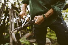 Well, how could I NOT notice how his arms flexed as he used his hatchet to sharpen the piece of wood in his hand.