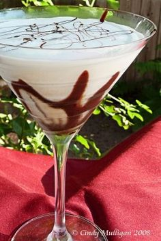 White Chocolate Martini, using  white Godiva liquor...may substitute half and half with ice cream and milk chocolate/ raspberry sauce is optional...enjoy!!!