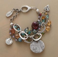"""TRIPLE RAINBOW BRACELET--Faceted apatite, imperial topaz, kyanite, chalcedony and spinel follow inspirational sterling charms over the rainbow. Adjustable sterling lobster closure. Handmade by Jes MaHarry. Made in USA. Exclusive. 7"""" to 7-3/4""""L."""
