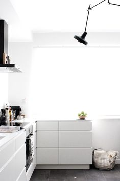 Black and white kitchen in the Scandinavian inspired Bulgarian home of Ivelina at FriChic.