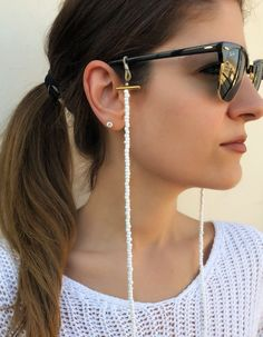 Sunglasses chain in a unique design made from white beads. Gold Sunglasses, Sunglasses Women, Sunglasses Holder, Fake Glasses, White Beads, Sunglass Frames, Metal Beads, Eyeglasses, Fashion Accessories