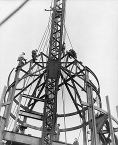 Construction workers assembling the framework of the mooring mast of the Empire State Building, New York City, c. 1931.  Lewis W. Hine/George Eastman House/Getty Images