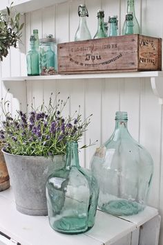 Things I love all in one place: old bottles, galvanized steel, wooden boxes and lavender.