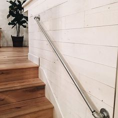 """This past weekend's projects: wood wall (we used stik wood and love it! its an easy way to add texture to any space)  the color is """"Hampton"""" and a railing made from industrial piping"""