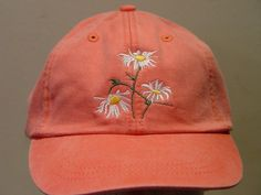 NEW EMBROIDERED WHITE FIELD DAISY FLOWER WILDLIFE GARDEN HAT (HATS PICTURED ARE CORAL AND BLACK) Adams Optimum 6 Panel Baseball Hat Low Profile – 100% Cotton Twill Adult Cap Pigment Dyed – Garment Washed Hat 6 Panels with Sewn Matching Eyelet Visor with 3 Rows of Stitching Pre-formed Bill - Leather Strap with Brass Grommet Adjustable – One Size Fits Most An Extremely Comfortable Baseball Hat! Enjoy the Embroidered White Field Daisies Flower Hat Please Choose Your Color Hat We have 2...