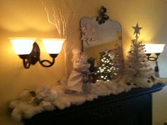 My living room mantel done in white and brown for the holiday.