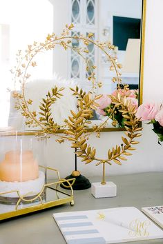 How to Design a Fabulous Home Office Space. MAke it pretty, somewhere to enjoy the work that has to be done!- Randi Garrett Design gold laurel wreath accessory