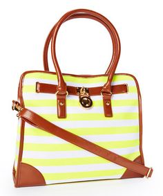 Add a splash of fancy-free style to a look with this nautical-inspired handbag. Featuring vibrant stripe canvas with genuine leather trim and riddled with pockets, its versatile design is sure to make a fashion statement wherever it goes!