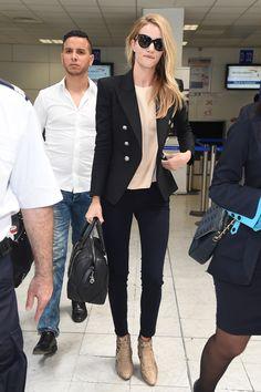 Rosie Huntington-Whiteley looks oh-so-cool in snakeskin booties at Nice Airport in France. via @stylelist