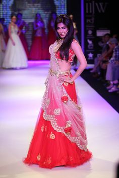 Chitrangada Singh was in a coral coloured lehenga choli with a transparent drape thrown over it at IIJW 2014. #Style #Bollywood #Fashion #Beauty #IIJW