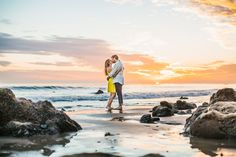 """Why We Love It: The beach at sunset makes a beautiful backdrop for engagement photos!Why You Love It:""""It's so laid back, and you can obviously see the love in the picture.""""—Kristin A. """"Stunning shot!""""—Diana E. """"This is so precious; it looks very natural, and you can definitely see their love for each other. Plus, it's a gorgeous setting!""""—Jenna K.Photo Credit: Marianne Wilson Photography"""