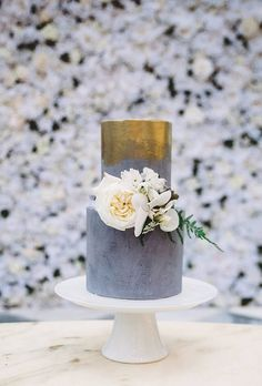 Modern Gold and Gray Wedding Cake with Flowers | Brides.com