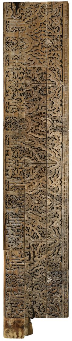 A LARGE CARVED WOOD FRIEZE PANEL, ALMOHAD OR MERINID, SPAIN OR MOROCCO, 12TH-13TH CENTURY