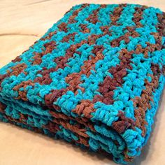 Easy Crochet lapghan. 3 skeins Bernat Blanket yarn (Mallard Wood) and ...