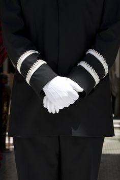 Our concierge team welcomes you.  In a  uniform of contrasting white on black.