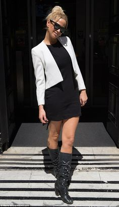 Mixing business with pleasure: Sarah Harding looked ready to talk business in a short blac...
