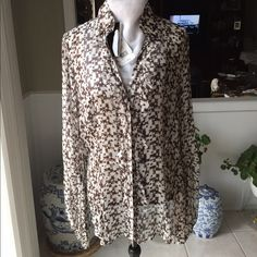 Nwt...Escada 100% silk chocolate and white blouse Nwt.. New...Escada chocolate and white 100% silk blouse. Delicate ruffle down the front with Escada stamped buttons. See photos for detailing. (Extra button included on interior label) No trade, no pp, smoke free environment Escada Tops Blouses