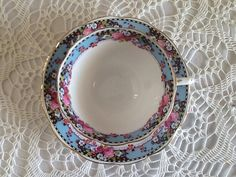 Here is a Royal Albert pink, white and orange floral patterned teacup set with a blue border. AGE: 1925-1927. The crown China back stamp dates this set to the 1920s! CONDITION: This set is in good vintage condition with no chips, cracks or crazing. Firing specs are visible on both pieces.There is minimal wear on the gold gilt trim. MEASUREMENTS: Saucer Width: 5 1/2(14cm) Cup Width: 3 3/4(9.5cm) Height: 2 1/2(6.5cm) U.S. and International customers shipping cost quoted may not ...