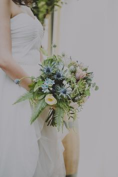thistle, succulent, and fern bouquet // photo by Chellise Michael, flowers by Sprout Home // http://ruffledblog.com/elegant-brooklyn-winery-wedding