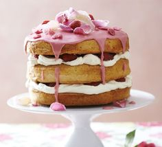 Recipe ... English Rose Cake  A stunning floral layer cake, flavoured with rosewater and layered up with vanilla cream, raspberry icing and crystallised petals BBC Good Food