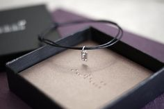 Braille charm necklace or bracelet. Made of sterling silver. Nickel free. Shop exclusive design and high quality pieces at Juliette et Josephine online store.