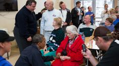 President Obama and New Jersey Gov. Chris Christie talk with local residents at the Brigantine Beach Community Center in Brigantine, New Jersey, on Oct. 31, 2012.