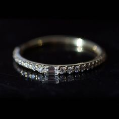 A sleek and sparkly ring that's also pretty romantic. A very fancy stacking ring (yes please!), a subtle wedding band to sneak under your engagement ring, OR a wedding band and engagement ring all-in-one! Princess Wedding Rings, Wedding Bands, Diamond Bracelets, Diamond Bands, Silver Bracelets, Silver Ring, Silver Jewelry, Fine Jewelry, Art Deco Ring