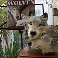 This sculpture is made off ceramic. Wolves are loyal to each other for life. That is how I see my life with my husband Leon. He is sweet , loyal and very supportive.