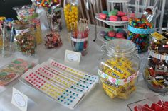 Candy table display @Becky Isom I like the paper wrapped around the jars. we could do something like this with the paper pack I have if you don't want to do the labels.