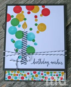 Fun circles made with a sponge dauber and Q-tip match the colors of the washi tape peeking out from the inside.  A single birthday candle is all you need on this handmade birthday card.