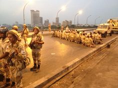 Twitter / IvanCNN: Egyptian soldiers praying on the Jemaa bridge across the nile River at sunset in Cairo