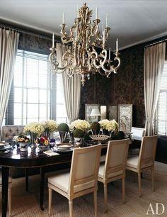 Dark walls, light curtains, gold accent
