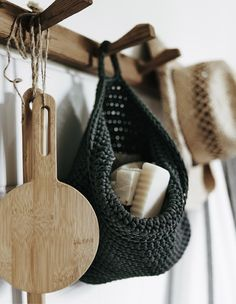 Keep everyday bathroom items easy to reach in baskets and bags on a line of hooks | #IKEAIDEAS