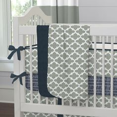 """Crib Bedding Blanket in Navy and Gray Quatrefoil by Carousel Designs.  Our soft and lightweight crib blanket is just the thing to wrap your baby up, snug as a bug in a rug. At 34"""" x 43"""", it's the perfect size for the newest addition to the family."""