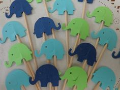 "Elephant Cupcake Toppers - Lime Green Aqua Blue and Navy Blue - Party Picks - Baby Shower Appetizer Picks (Set of 24). 24 Elephant Cupcake toppers / food picks Perfect for your baby shower or birthday! Amount: 24 picks size: approx. 3"" tall and Elephants are 1"" . Each is Double sided - like all of my food picks ~ so they look great from all sides! ~~ Colors may vary slightly on computer screen. ~~ The key to a great party is in the details! These cute cupcake toppers / food picks are the..."