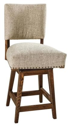 Amish Tiana Upholstered Swivel Stool Love the upholstered look at the kitchen counter? Tiana bar stools swivel and support in your choice of upholstery, wood and satin. Fine craftsmanship from Amish country that will outlast other stools. #barstools #swivelstools